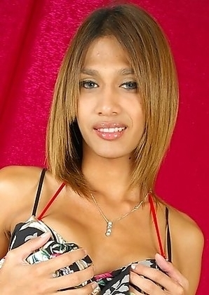 Big breasted Bangkok ladyboy Yoyo is back in a solo scene wearing a long dress and being naughty as ever.