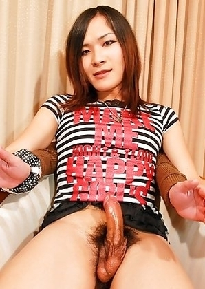 Ayumi is a rocker type shemale with black knee highs and a slutty plaid skirt!