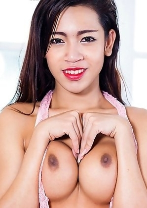 Ann is a sexy petite Bangkok girl with a smoking hot body, nice tits and a sexy uncut cock!
