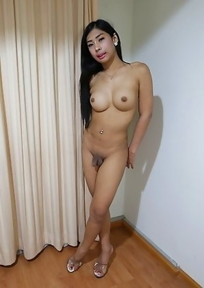 20yo busty Thai shemale Arin sucks and fucks a big white cock after stripping