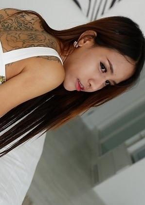 19yo Thai ladyboy Tontan with big fake tits sucks white cock