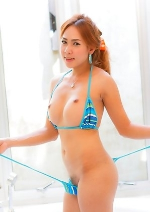 Soft body Ladyboy Nong shares her pretty cock balls and asshole in a tiny bikini