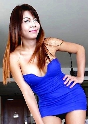 Wild busty Thai Ladyboy Nadia with big penis extracts foreign cum