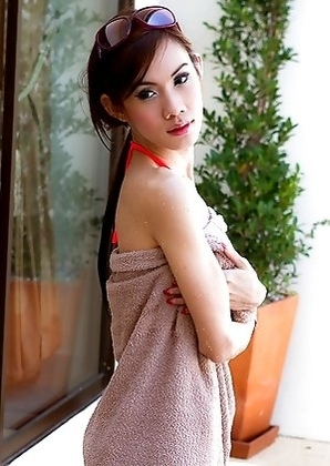 Ladyboy A strips from bright bikini and goes for a swim