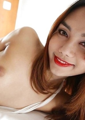 Lovely Thailand ladyboy Ning takes white pipe up the ass