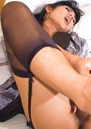 Slick and shiny Ladyboy peggy feet caress a thick black dildo