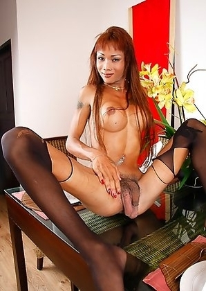 Ladyboy Em has her huge balls swing while ravished by 2 big cocks