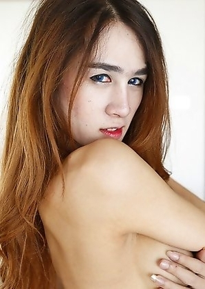 Thai ladyboy Four with big fake tits and long hair gets facial from tourist