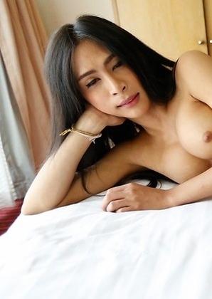Sexy Thai ladyboy Pang  sucking big white cock