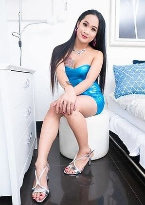 Ladyboy Anna slips out of her black dress and into a shimmering blue one with silver heels and pink panties.