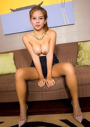 Aum strips off her black shorts suit, displaying her big tits and meaty post-op clam and puts on a masturbation show. Aum uses her fingers and a glas