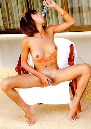 Ladyboy Palm cock is hard as she tans by the pool
